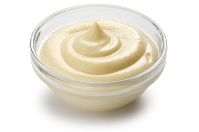 homemade mayonnaise on white background